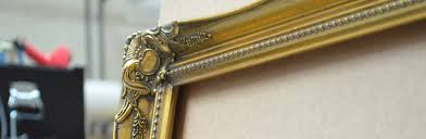 an example of a gold ornate picture frame