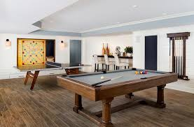 game room lighting. Under A Tray Ceiling Accented With Blue, This Well Appointed Game Room Boasts Pool Table And Ping Pong Shiplap Walls Holding Chalkboard Beside Lighting