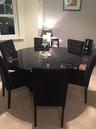 6 seater black glass dining table and next velvet chairs chea
