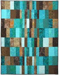 Morning Noon & Night Quilt Kit Finished size: x This beautiful turquoise  and brown batik quilt was designed by Atkinson Designs.