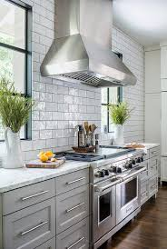 view full size well appointed gray kitchen features glazed white subway backsplash tiles finished with dark gray grout