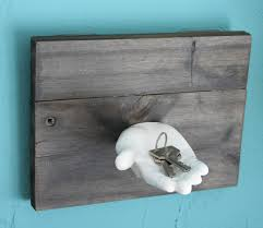 white ceramic hand key holder for wall with wooden plank