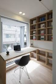 office study designs. nice way of joining desk and top bookcase interesting angle office study designs