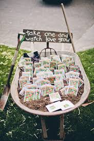 seed packet wedding favors displayed in a rustic wheelbarrow