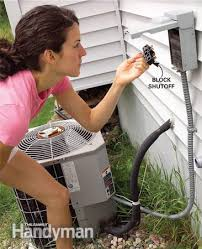 clean your air conditioner condenser unit the family handyman photo