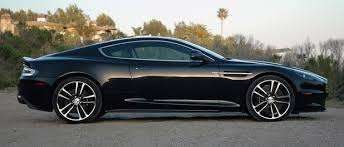 aston martin vanquish blacked out. itu0027s the eating of all those visible light waves that puts dbs carbon black at top for us because it swallows bodywork lines and other details aston martin vanquish blacked out w