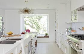 brass sputnik chandelier over kitchen dining table