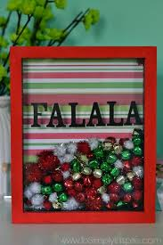 make this easy diy holiday shadowbox frame for a cute little addition to your holiday decorations
