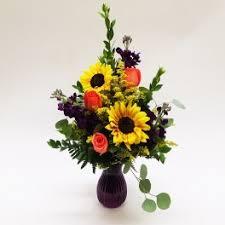 rays of sunflowers vase