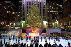 Skaters take to the ice in front of the Rockefeller Center Christmas tree.