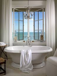 elegant chandelier and vintage bathtub shape a dreamy bathroom design jill shevlin design