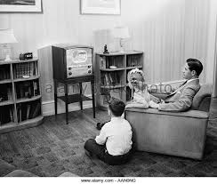 kids watching tv black and white. 1940s 1950s father with two children watching television - stock image kids watching tv black and white