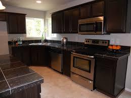 awesome black dark granite countertops with dark cabinets in white kitchen design with chrome kitchen appliances