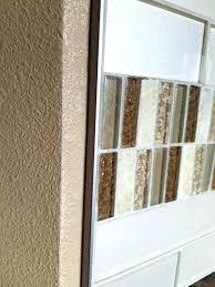 schluter tile edging tile trim glass tile with a satin nickel metal edge trim tile trim schluter tile edging