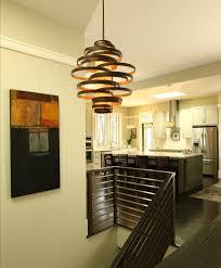 stylish kitchen near modern dark staircase under modern pendant lighting fixtures with unusual design