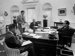 nixon oval office. photo president richard nixon sits at his desk in the oval office during a meeting