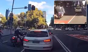Beating Red Light Demerit Points Driver Checks Their Phone At Lights Without Realising They