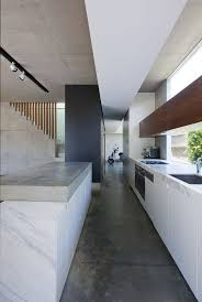 Love the rich white carrara marble counter tops in this minimalist kitchen  at the Queens Park House by MCK Architects