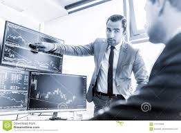 Stock Brokers Stock Brokers Trading Online In Corporate Office Stock Photo