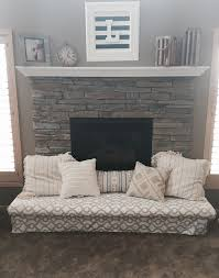 baby proof the fireplace hearth with a padded bench