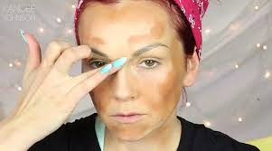 first step kandee begins her transformation by dabbing herself with a darker shade of foundation