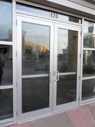commercial double glass doors cost of clopay avante garage door insulated gl roll up luminous mirrored