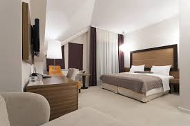 office space in bedroom. This Bedroom Has An Angled Ceiling, With Curtains That Run From The Highest Point Down Office Space In S