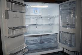 kenmore fridge inside. this is great from an interior storage perspective but it makes the shelves on that door very shallow. we tend to put condiments kenmore fridge inside
