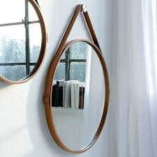 george hanging round mirror features leather wrapped steel frame with buckle strap and stainless steel hanging hardware details available in multiple