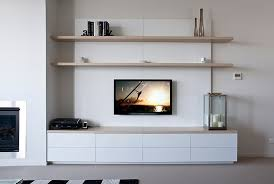 low line entertainment unit with two large floating shelves push catch drawers for a clean finish