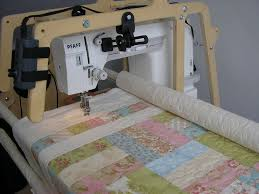 Quilting frames | Popular Patchwork & The Pfaff Grandquilter mounted on the Little Gracie II frame, with a quilt  part-quilted. If you look at the rail visible on the right-hand of the  picture, ... Adamdwight.com