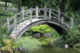 how to build a wooden bridge arched wooden bridge over an algae filled pond plans for