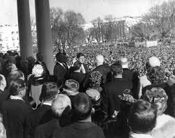 an inaugural speech like and so very unlike those before it us supreme court chief justice earl warren center administered the oath of office to