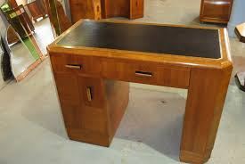 nice walnut and teak veneered las desk with black and gold tooled leather top discreet storage space in knee hole 2 drawers and a cupboard