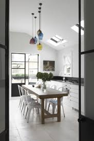 beautiful small kitchen ideas with nice colorful glass pendant lights above rectangle solid wood dining table be equipped six gray polished iron dining