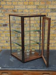 english antique display cabinet. antique display cabinet removed from a tool shop heavy duty but delicate oak frame with english t