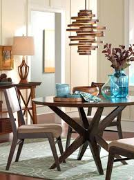 over dining table chandeliers a modern chandelier hangs over a dining room table dining room chandelier over dining table chandeliers