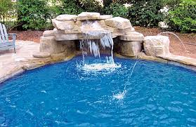 ... Swimming pool with rock waterfall grotto and laminar jets ...