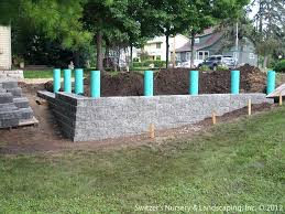 versalock wall versa retaining wall install fence post sleeve with grid by versalock wall versalock wall versa is retaining