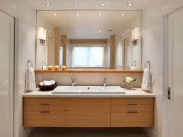 brown finish maple wood storage van light blue bathroom ideas black towel beside sink ceramic undermount sink lighting bulb sconce cool wall lamp