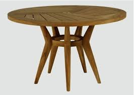 round wooden table above the dining in teak is at restoration hardware and chairs for toddlers