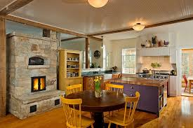 farmhouse style kitchen ideas purple island with wooden countertop rounded table with yellow chairs stone fireplace exposed ceiling beams white tile