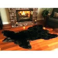 faux animal skin rugs rug bearskin in front of fireplace designs fake with head sheepskin r fake animal skin faux cowhide rug