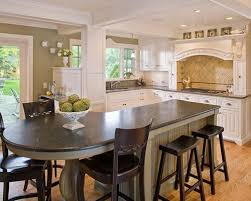 kitchen island table combination. Example Of A Mid-sized Classic L-shaped Light Wood Floor Eat-in Kitchen Island Table Combination