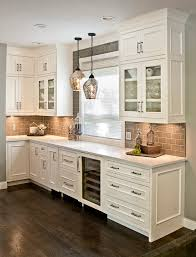 custom dove white cabinets with large cove moldings panelized ends