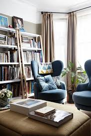 armchairs for small rooms uk. a small room with tall narrow bookcases, grey walls \u0026 contemporary armchairs. modern and armchairs for rooms uk m