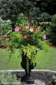 Pink flowers and lime greens in a black urn | 21 Gorgeous Flower Planter  Ideas to