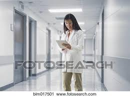 Doctor Reading Chart Asian Doctor Reading Medical Chart In Hospital Stock Image