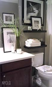 Black & White photos of some vacation pictures as powder room decor. --I