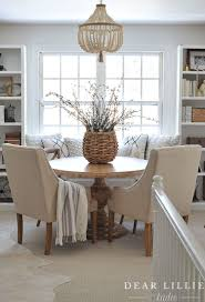 we love using baskets as vases and filling them with flowers including this one from homegoods it works great at this round game table in our bonus room